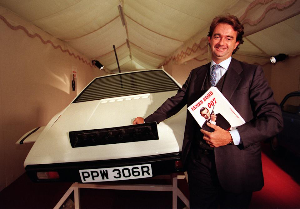 Italian businessman Domenico Morassutti with the 1977 Lotus Espirit S1 Submarine Shell as featured in the James Bond film The Spy Who Loved Me.  Mr Morassutti bought the Lotus shell for  29,000 (includes auctioneer's 15% comission) at the 007 auction at Christie's in London today (Thursday).  See PA story SALE Bond.  Photo by Matthew Fearn/PA   (Photo by Matthew Fearn - PA Images/PA Images via Getty Images)