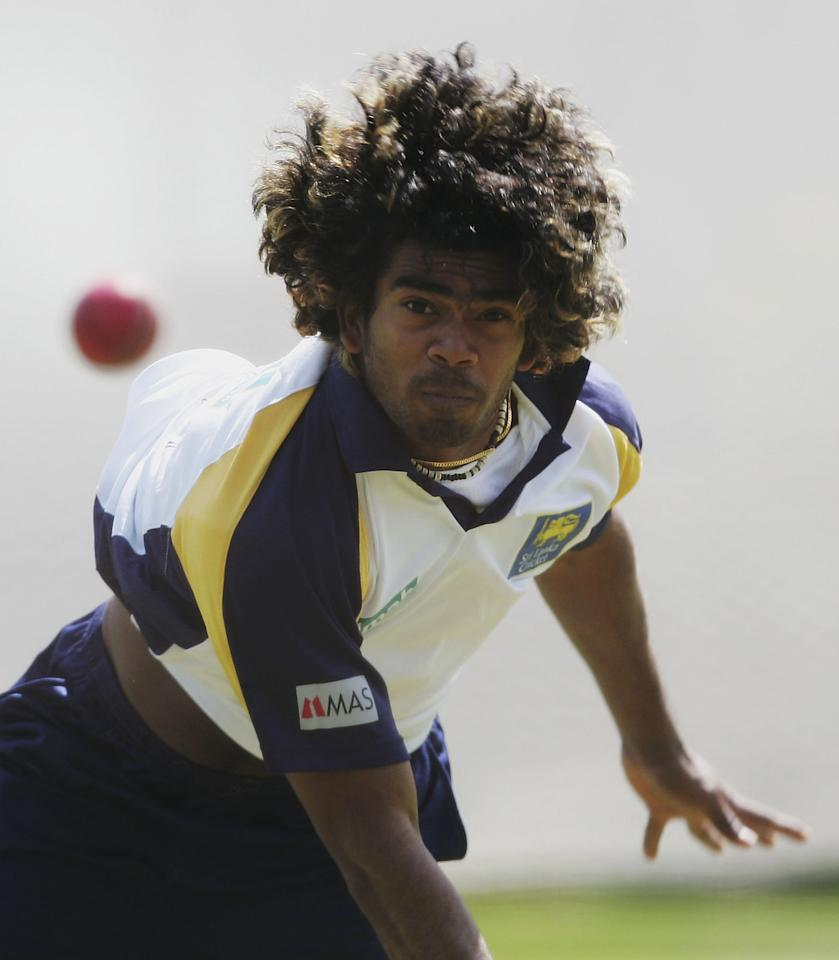 BIRMINGHAM, UNITED KINGDOM - MAY 23:  Lasith Malinga of Sri Lanka bowls during Sri Lanka net practice at the Edgbaston Cricket Ground on May 23, 2006 in Birmingham, England.  (Photo by Shaun Botterill/Getty Images)