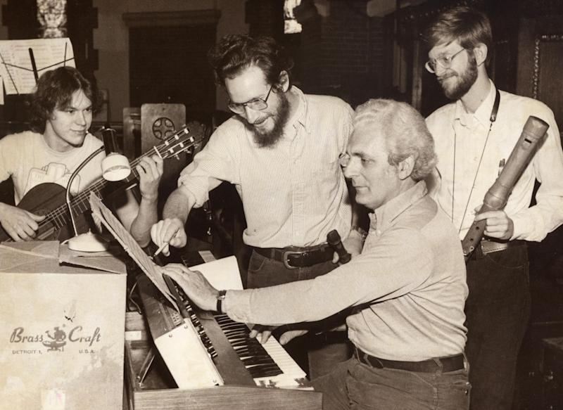 FILE - In this May 3, 1980 file photo, synthesizer pioneer Robert Moog, second right, performs with the Going Baroque Band at All Souls Episcopal Church in Asheville, N.C. On Wednesday, May 23, 2012, Google amplified Moog's mission and put synthesis in the hands of millions of people via a fully functioning special interactive synthesizer on its homepage to commemorate what would have been Moog's 78th birthday. The Moog doodle, a replica of the Minimoog Model D, may not be a highly complex synthesizer but it explores a lot of the realms of synthesis. (AP Photo/Asheville Citizen-Times, File)