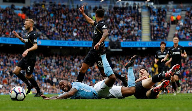 "Soccer Football - Premier League - Manchester City v Swansea City - Etihad Stadium, Manchester, Britain - April 22, 2018 Manchester City's Raheem Sterling is fouled by Swansea City's Federico Fernandez resulting in a penalty to Manchester City REUTERS/Phil Noble EDITORIAL USE ONLY. No use with unauthorized audio, video, data, fixture lists, club/league logos or ""live"" services. Online in-match use limited to 75 images, no video emulation. No use in betting, games or single club/league/player publications. Please contact your account representative for further details."