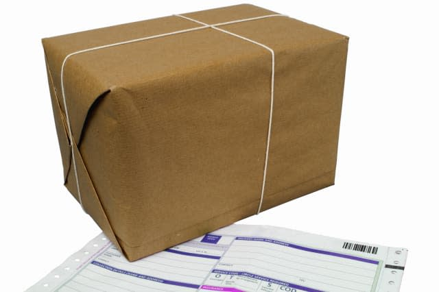 Close up of a delivery document and a parcel