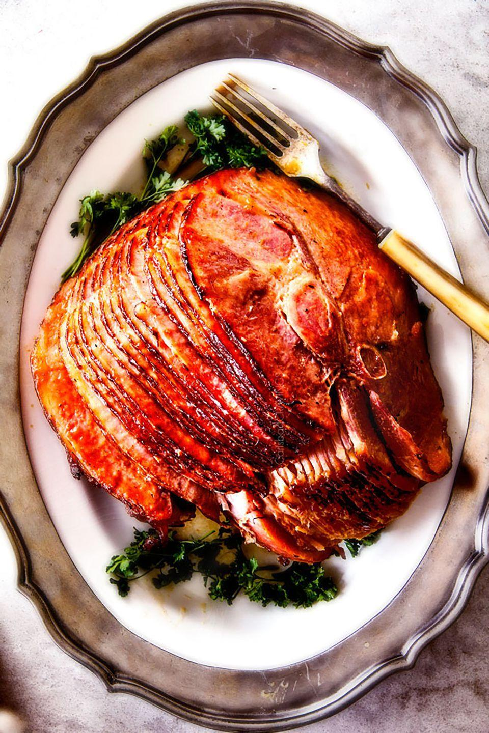 """<p>This easy, caramelized dish only requires minutes of hands-on-prep—giving you more time to play some reindeer games.</p><p><strong>Get the recipe at <a href=""""http://carlsbadcravings.com/baked-ham-with-apple-cider-maple-glaze/"""" rel=""""nofollow noopener"""" target=""""_blank"""" data-ylk=""""slk:Carlsbad Cravings"""" class=""""link rapid-noclick-resp"""">Carlsbad Cravings</a>.</strong> </p>"""