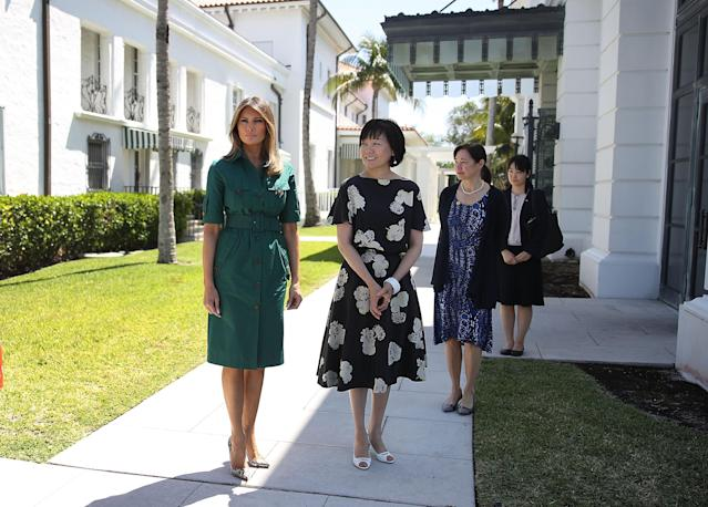 <p>For the second day of Japanese Prime Minister Shinzo Abe and his wife Akie Abe's visit to the White House visit, Melania Trump dressed in a forest green shirt dress in Palm Beach. <em>[Photo: Getty]</em> </p>