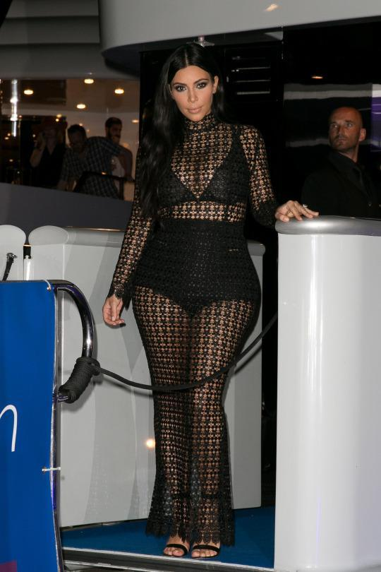 Pregnant Kim Kardashian Continues to Wear Crop Tops & Sheer Gowns