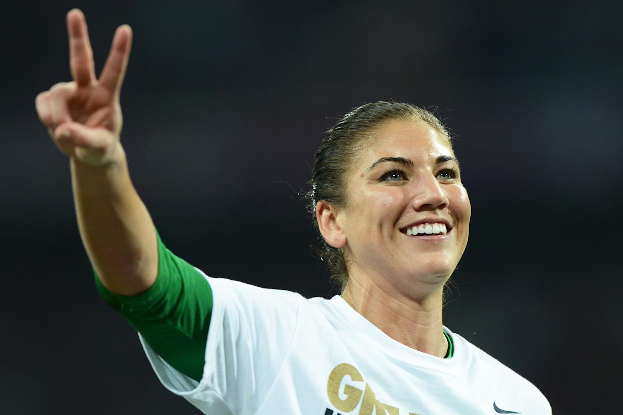 LONDON, ENGLAND - AUGUST 09:  Hope Solo #1 of the United States celebrates after defeating Japan by a score of 2-1 to win the Women's Football gold medal match on Day 13 of the London 2012 Olympic Games at Wembley Stadium on August 9, 2012 in London, England.  (Photo by Michael Regan/Getty Images)