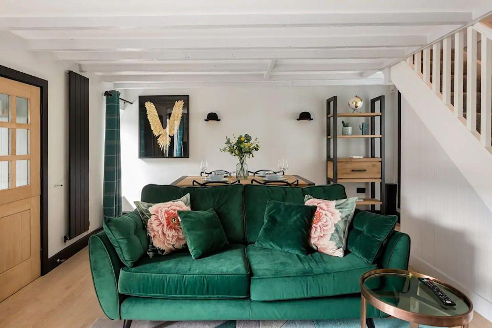 "<p>Set within reach of dreamy South Hams beaches and the Dartmoor National Park, this intimate hideaway is ideal for combining the coast and country for a heavenly escape to Devon. You can sink into the emerald velvet sofa, light the log burner, curl up in the window seat and have a thoroughly relaxing time.</p><p><strong>Sleeps: </strong>4</p><p> <strong>Make sure you... </strong>Head out for a pub lunch in the nearby village of Brixton.</p><p><strong>Price per night:</strong> £126</p><p><a class=""link rapid-noclick-resp"" href=""https://airbnb.pvxt.net/LPXrMo"" rel=""nofollow noopener"" target=""_blank"" data-ylk=""slk:BOOK HERE"">BOOK HERE</a></p>"