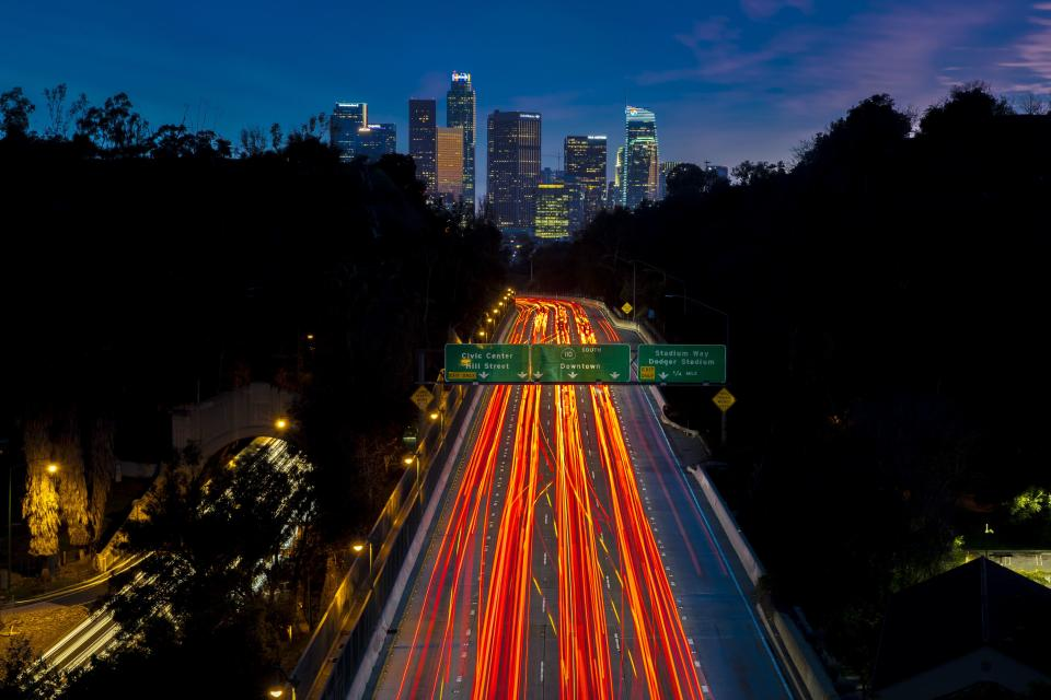 Pasadena Freeway, Arroyo Seco Parkway, CA 110 leads to downtown Los Angeles with streaked car lights at sunset. (Photo by: Visions of America/Education Images/Universal Images Group via Getty Images)