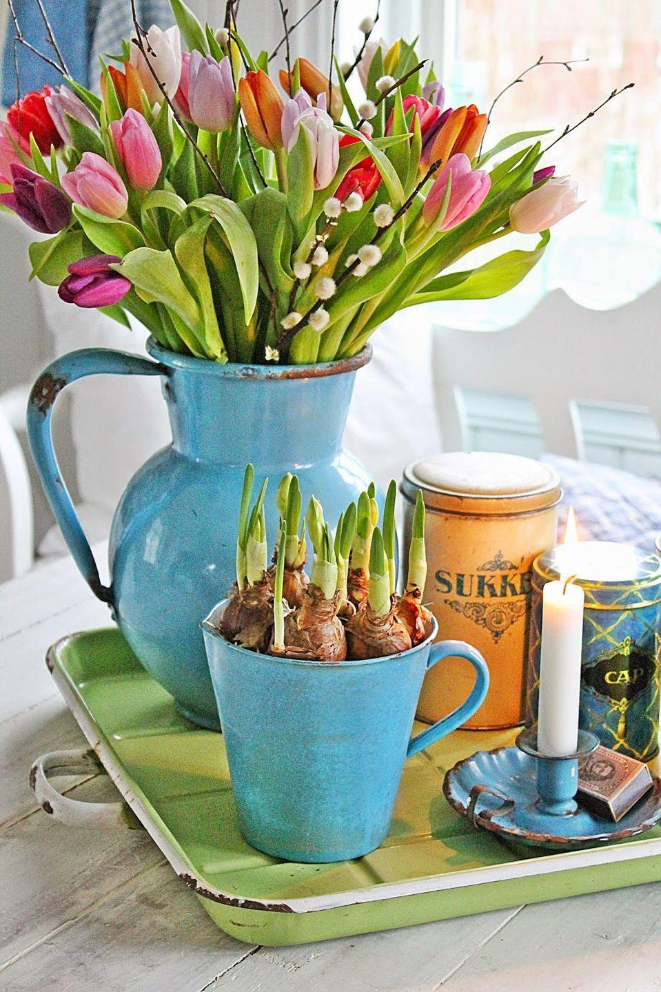 """<p>For an adorable duo, place cut flowers in a large vase or pitcher. Then pair the bouquet with bulbs planted in a matching mug or bowl.</p><p><em><u><a href=""""http://vibekedesign.blogspot.nl/2015/02/fargefest.html"""" rel=""""nofollow noopener"""" target=""""_blank"""" data-ylk=""""slk:Get the tutorial from Vibeke Design »"""" class=""""link rapid-noclick-resp"""">Get the tutorial from Vibeke Design »</a></u></em></p>"""