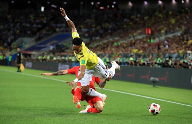 <p>England's Kieran Trippier (left) and Colombia's Johan Mojica battle for the ball during the FIFA World Cup 2018, round of 16 match at the Spartak Stadium, Moscow. (Photo by Adam Davy/PA Images via Getty Images) </p>