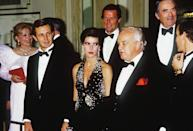 <p>Princess Caroline glittered at a party in L.A. surrounded by Hollywood legends Roger Moore, Gregory Peck, and Frank Sinatra.</p>