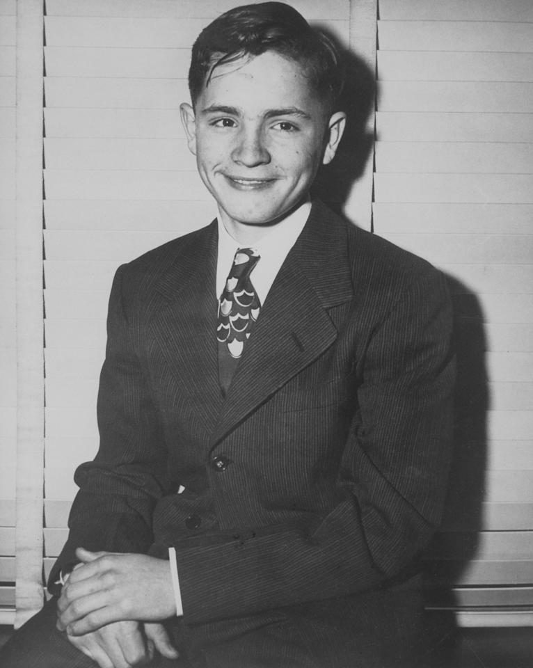 <p>Three days before he ran away from Boys Town in Omaha, Charles Manson poses in a suit and tie. (Photo: Bettmann Archive/Getty Images) </p>