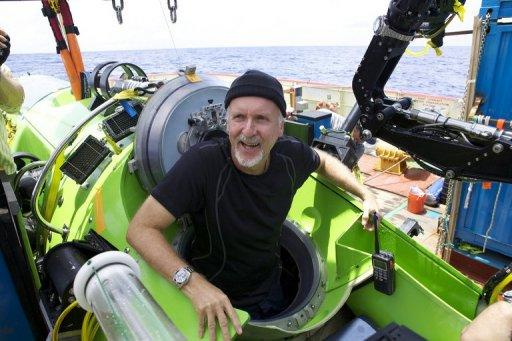 "Explorer James Cameron emerges from the Deepsea Challenger submersible after his successful solo dive to the Mariana Trench, the deepest part of the ocean. Cameron described a barren ""completely alien world"" on the ocean floor"