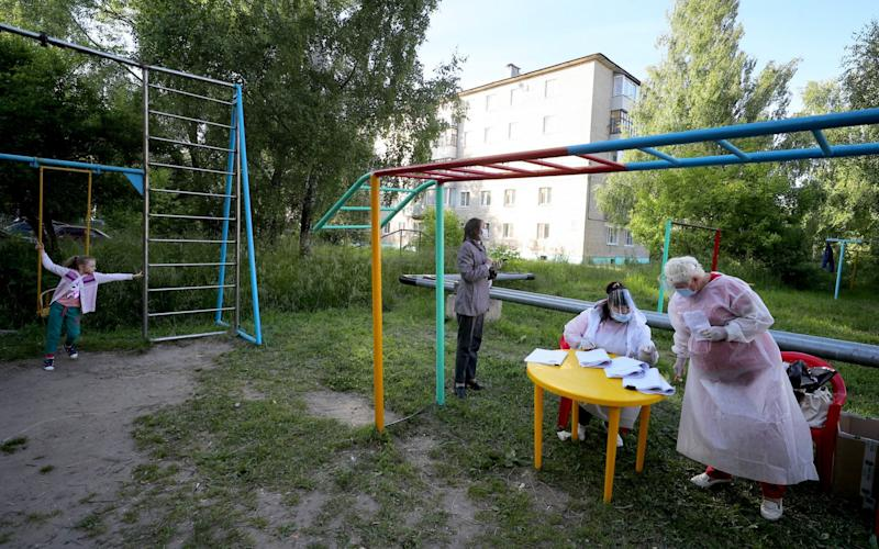 Many polling stations outside Moscow were working in outdoor settings - Vladimir Smirnov/Tass via Getty Images