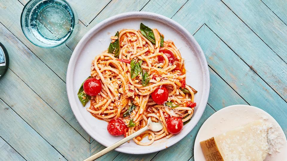 "Think of this weeknight-friendly pasta recipe as a lighter take on the classic Italian ragù that features cherry tomatoes, a red chile for some heat, and tons of fresh basil. It will also take you under an hour to make! <a href=""https://www.bonappetit.com/recipe/summer-bolognese?mbid=synd_yahoo_rss"" rel=""nofollow noopener"" target=""_blank"" data-ylk=""slk:See recipe."" class=""link rapid-noclick-resp"">See recipe.</a>"