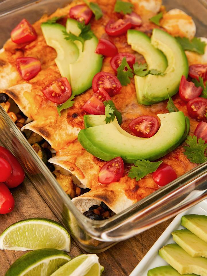 """<p>Definition of a healthy and hearty meal. </p><p>Get the recipe from <a href=""""https://www.delish.com/cooking/recipe-ideas/a23573506/vegetarian-enchiladas-recipe/"""" target=""""_blank"""">Delish</a>. </p>"""