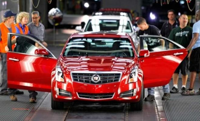 The first 2013 Cadillac ATS rolls off the assembly line at the General Motors Lansing Grand River plant on July 26.