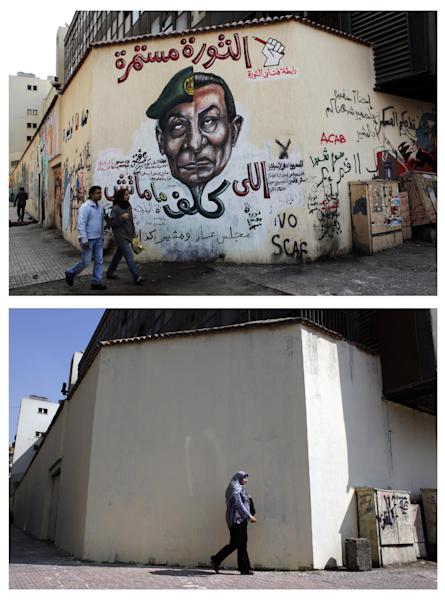 "This combo image of two photos taken in the same location; on March 22, 2012, above, an Egyptian couple walks by a mural depicting military ruler Field Marshal Hussein Tantawi on the left side of the face and ousted president Mubarak, right side with Arabic that reads, ""who assigned you did not die, No for gas export to Israel, the revolution continues"", top; a veiled Egyptian woman walks past a wall that was newly whitewashed during a cleanup campaign to erase old murals, in Tahrir Square, Cairo, Egypt, Wednesday, Sept. 19, 2012. Graffiti artists are repainting the walls in Mohammed Mahmoud Street, off Tahrir square, soon after municipal workers have whitewashed over a mural depicting the faces of victims of police brutality and violence over the past two years. (AP Photo/Nasser Nasser, File)"