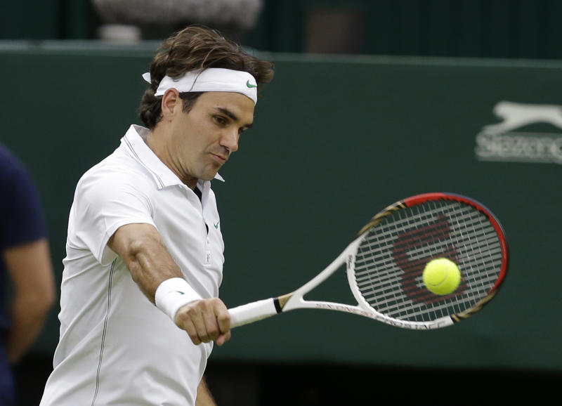 Roger Federer of Switzerland plays a shot to Novak Djokovic of Serbia during a men's semifinals match at the All England Lawn Tennis Championships at Wimbledon, England, Friday, July 6, 2012. (AP Photo/Kirsty Wigglesworth)