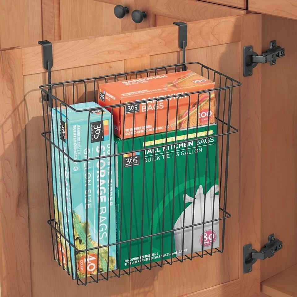 """<p>This <a href=""""https://www.popsugar.com/buy/MDesign-Metal-Wire-Hanging-Over-Door-Kitchen-Storage-Organizer-489053?p_name=MDesign%20Metal%20Wire%20Hanging%20Over-Door%20Kitchen%20Storage%20Organizer&retailer=amazon.com&pid=489053&price=20&evar1=casa%3Auk&evar9=46595837&evar98=https%3A%2F%2Fwww.popsugar.com%2Fhome%2Fphoto-gallery%2F46595837%2Fimage%2F46596293%2FMDesign-Metal-Wire-Hanging-Over-Door-Kitchen-Storage-Organizer&list1=shopping%2Camazon%2Corganization%2Ckitchens%2Chome%20organization%2Chome%20shopping&prop13=api&pdata=1"""" rel=""""nofollow"""" data-shoppable-link=""""1"""" target=""""_blank"""" class=""""ga-track"""" data-ga-category=""""Related"""" data-ga-label=""""https://www.amazon.com/mDesign-Hanging-Kitchen-Storage-Organizer/dp/B0731TSSTR/ref=sr_1_175?keywords=kitchen+organizers&amp;qid=1568055476&amp;s=gateway&amp;sr=8-175"""" data-ga-action=""""In-Line Links"""">MDesign Metal Wire Hanging Over-Door Kitchen Storage Organizer</a> ($20) is ideal for boxes or bags.</p>"""