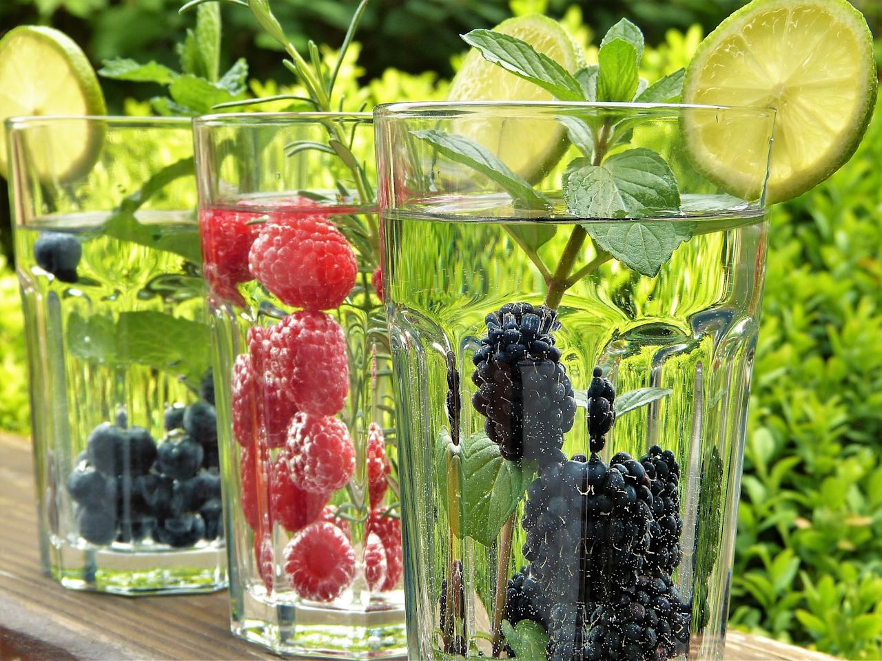 <p>There are plenty of ways to go beyond plain, boring H2O. Fruits in your water adds a little flavor (without adding in the sugar) that you'd find in fruit juices. Freeze some lemon slices in ice cubes for an easy water upgrade or try a little ginger and herbs to switch things up a bit. </p>