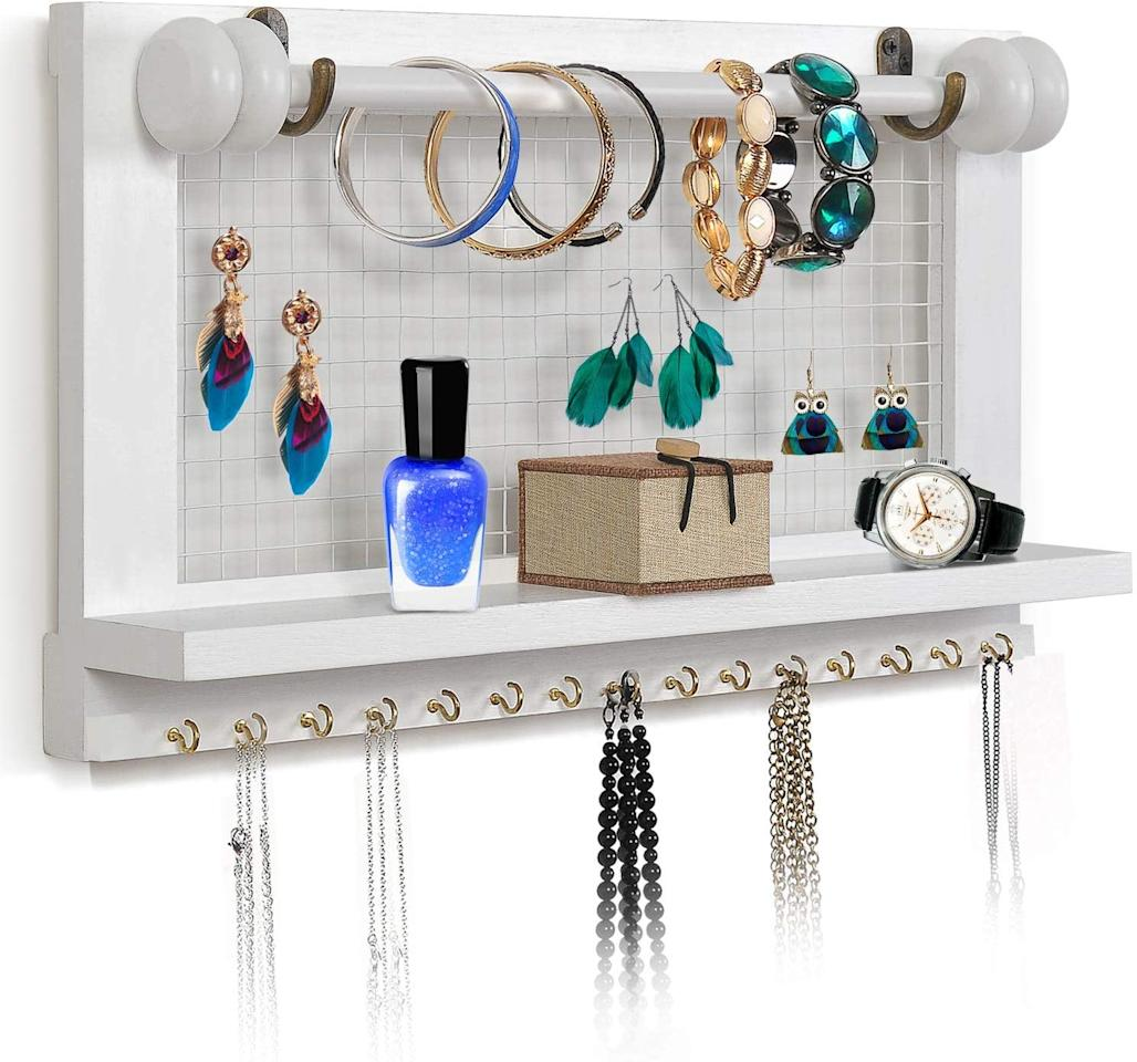 """<p>The different shelves and hooks on this <a href=""""https://www.popsugar.com/buy/Viefin-Wall-Mounted-Mesh-Jewelry-Organizer-493244?p_name=%20Viefin%20Wall-Mounted%20Mesh%20Jewelry%20Organizer&retailer=amazon.com&pid=493244&price=29&evar1=casa%3Aus&evar9=46665573&evar98=https%3A%2F%2Fwww.popsugar.com%2Fhome%2Fphoto-gallery%2F46665573%2Fimage%2F46666068%2FViefin-Wall-Mounted-Mesh-Jewelry-Organizer&list1=shopping%2Camazon%2Corganization%2Cbedrooms%2Chome%20organization&prop13=api&pdata=1"""" rel=""""nofollow"""" data-shoppable-link=""""1"""" target=""""_blank"""" class=""""ga-track"""" data-ga-category=""""Related"""" data-ga-label=""""https://www.amazon.com/VIEFIN-Wall-Mounted-Organizer-Necklace-Removable/dp/B07FDS5K83/ref=sr_1_7?keywords=bedroom+organizers+jewelry&amp;qid=1569260767&amp;s=gateway&amp;sr=8-7"""" data-ga-action=""""In-Line Links""""> Viefin Wall-Mounted Mesh Jewelry Organizer</a> ($29) are so useful.</p>"""