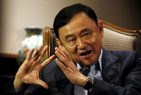 FILE PHOTO: Former Thai Prime Minister Thaksin Shinawatra speaks to Reuters during an interview in Singapore February 23, 2016. REUTERS/Edgar Su/File Photo