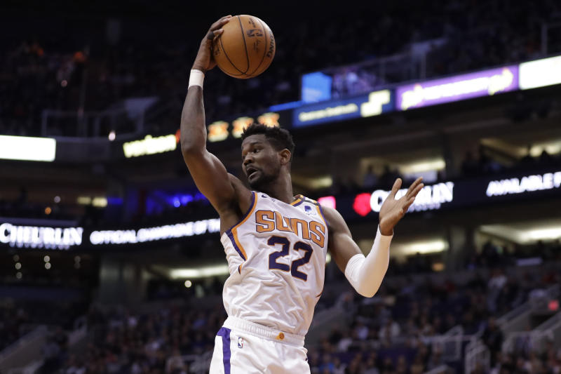 Phoenix Suns center Deandre Ayton (22) rebounds during the first half of an NBA basketball game against the Los Angeles Clippers, Wednesday, Feb. 26, 2020, in Phoenix. (AP Photo/Matt York)