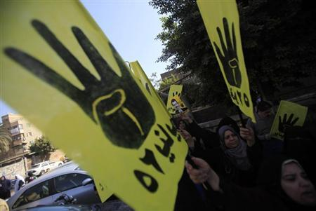 Supporters of Muslim Brotherhood and ousted Egyptian President Mursi shout slogans against military and interior ministry in front of Al Rayyan mosque after Friday prayers in the southern suburb of Maadi, outskirts of Cairo