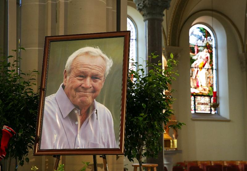 Arnold Palmer's portrait is displayed on the alter during a Celebration of Arnold Palmer at Saint Vincent College on October 4, 2016 in Latrobe, Pennsylvania (AFP Photo/Hunter Martin)