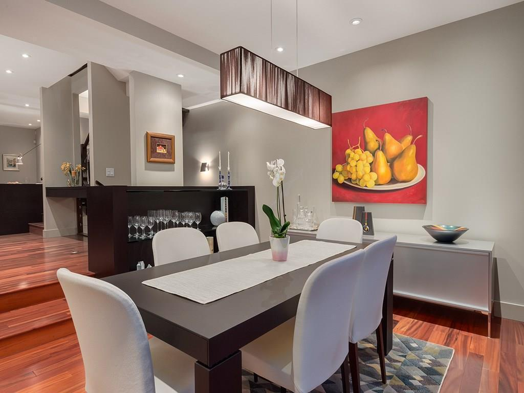 """<p><a rel=""""nofollow"""">2305 3 Avenue NW, Calgary, Alta.</a><br /> This 2,215-square-foot home is south-facing, and has cherry tiger hardwood floors as well as many other architectural upgrades.<br /> (Photo: Zoocasa) </p>"""
