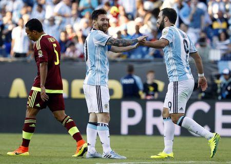 Jun 18, 2016; Foxborough, MA, USA; Argentina midfielder Lionel Messi (10) congratulates forward Gonzalo Higuain (9) after he scored his second goal of the game against the Venezuela during the first half of quarter-final play in the 2016 Copa America Centenario soccer tournament at Gillette Stadium. Mandatory Credit: Winslow Townson-USA TODAY Sports / Reuters.