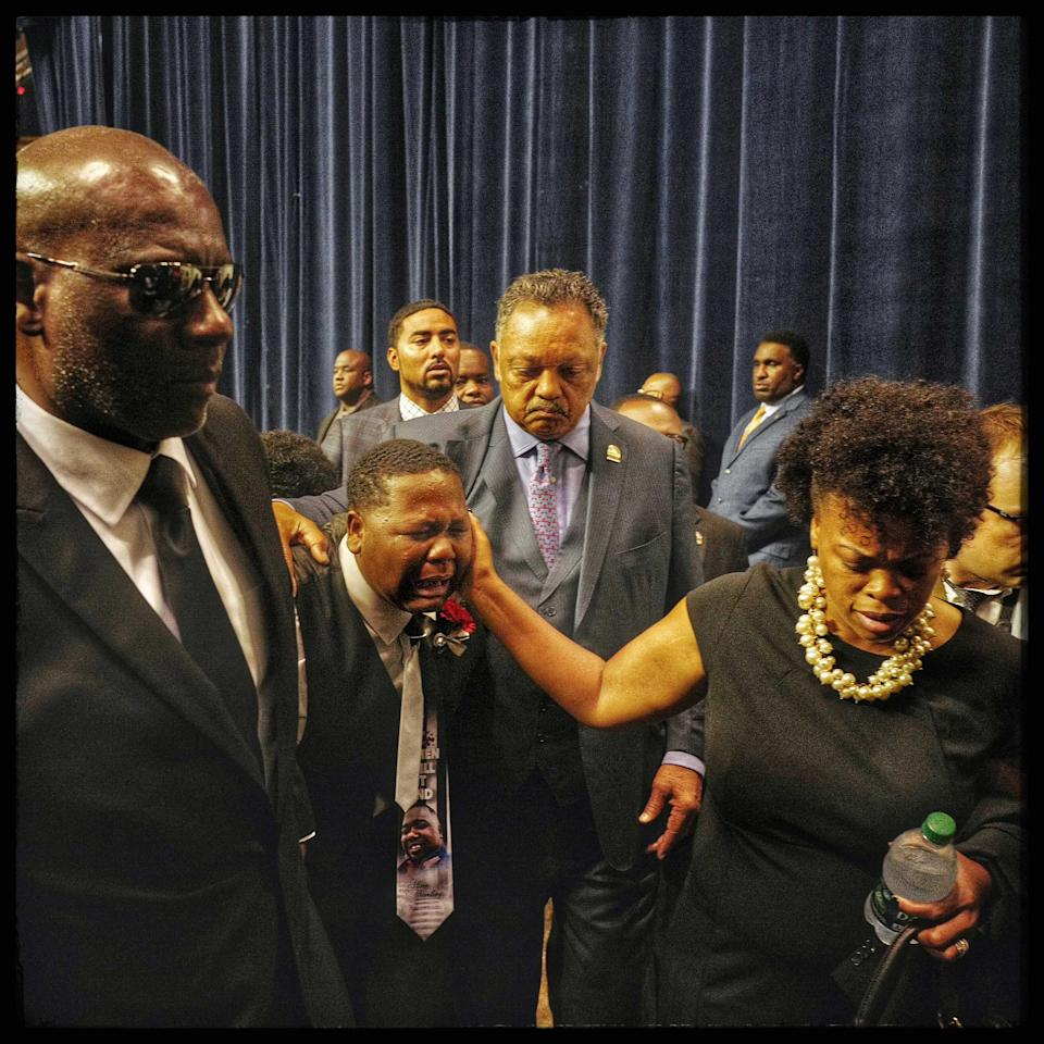 Baton Rouge, La: Fifteen-year-old Cameron Sterling succumbs to the pain as he is led out of the funeral of his father, Alton Sterling, accompanied by the Rev. Jesse Jackson Sr. The funeral was held at the Southern University A&M College on July 15, 2016.