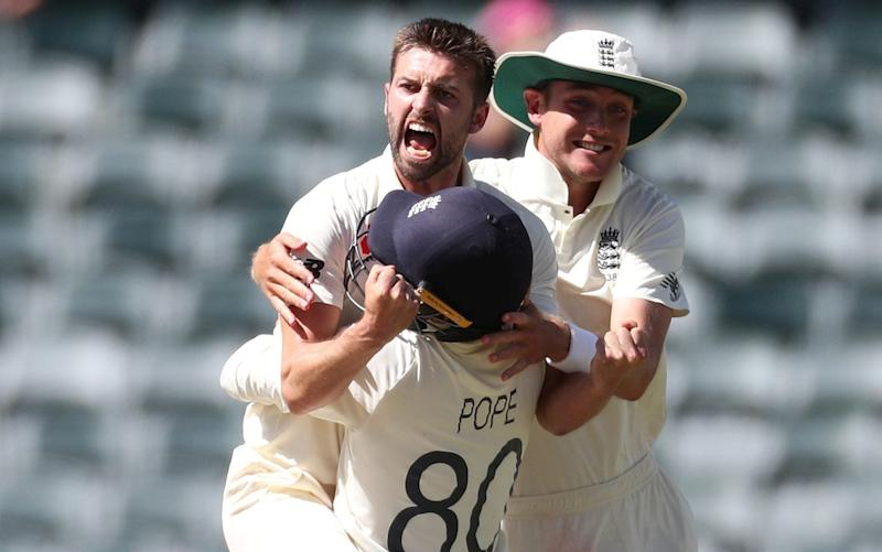 Mark Wood takes four wickets in the second innings in a man-of-the-match, match-winning performance for England - REUTERS