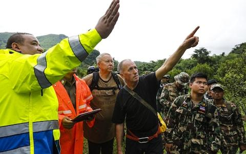 British caver Vernon Unsworth (centre) works with with Thai army soldiers and local rescue personnel during the rescue operation - Credit: AFP