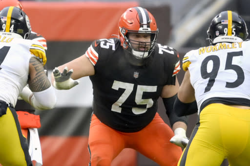 FILE - Cleveland Browns offensive guard Joel Bitonio (75) blocks in the third quarter an NFL football game against the Pittsburgh Steelers in Cleveland, in this Sunday, Jan. 3, 2021, file photo. Browns Pro Bowl left guard Joel Bitonio will be activated from the COVID-19 list Friday, Jan. 15, 2021, after missing last weeks playoff win over Pittsburgh. (AP Photo/David Richard, File)