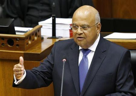 Pravin Gordhan delivers his 2014 budget address in Parliament in Cape Town February 26, 2014. REUTERS/Mike Hutchings