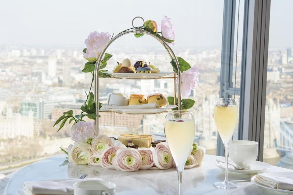 """<p>To celebrate May 19, The Shard's hotel Shangri-La is offering guests the ultimate 'Royal Celebration Experience'. Those wishing to celebrate the big day will be offered a night's stay in one of the hotel's luxury suites with a bottle of champagne and a stack of pastel-hued macarons upon arrival. You can later enjoy a Royal Botanical Afternoon Tea finished with a Celebration Cocktail. Oh, the Queen will definitely approve.<br> Further details can be found on the <a rel=""""nofollow noopener"""" href=""""http://www.shangri-la.com/london/shangrila/offers/details/rooms-suites/the-royal-celebration-experience/"""" target=""""_blank"""" data-ylk=""""slk:website"""" class=""""link rapid-noclick-resp"""">website</a>. <em>[Photo: Shangri-La]</em> </p>"""