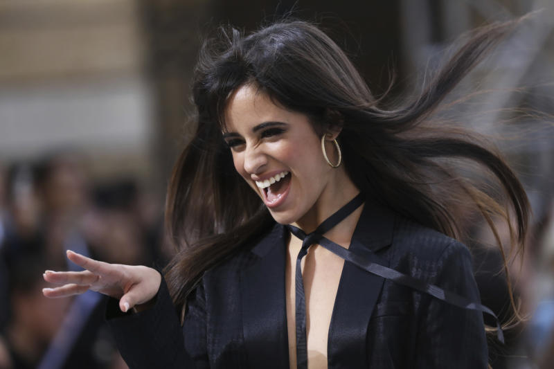 Singer Camila Cabello wears a creation as part of the L'Oreal Ready To Wear Spring-Summer 2020 collection, unveiled during the fashion week, in Paris, Saturday, Sept. 28, 2019. (Photo by Vianney Le Caer/Invision/AP)