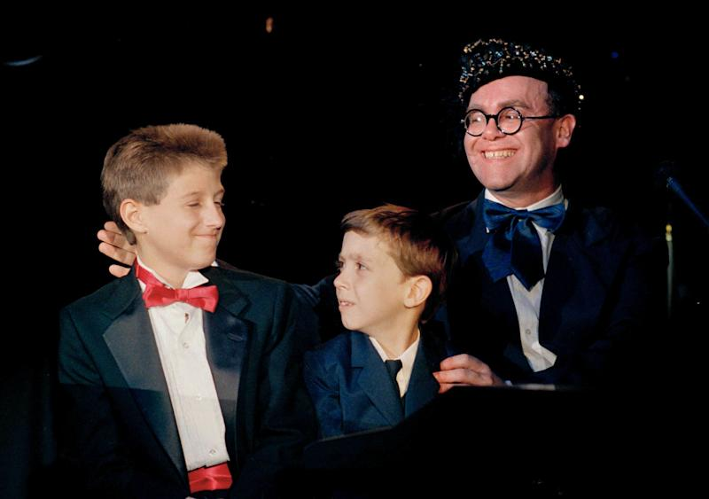 "AIDS activist Ryan White is seen far left of British pop singer Elton John at the ""For the Love of Children"" benefit for children with AIDS and other serious illnesses in Los Angeles in 1988. (Photo: ASSOCIATED PRESS)"