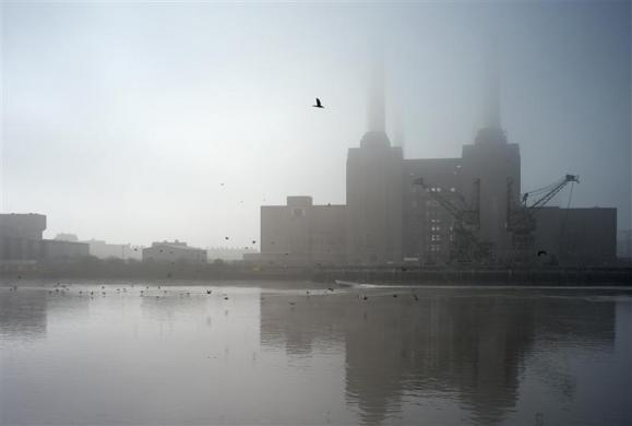 Battersea Power Station is shrouded in fog on the River Thames in London March 15, 2012.