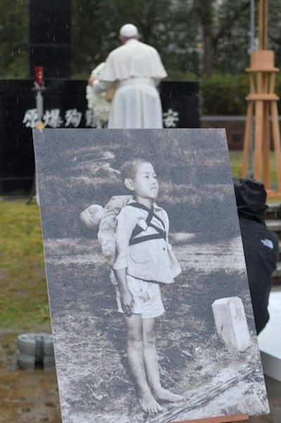 Pope Francis spoke while standing next to a photo of a young boy carrying his dead baby brother on his back in the aftermath of the Nagasaki nuclear bomb attack