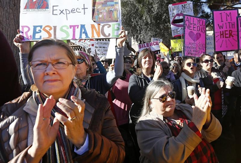 Demonstrators applaud speakers in support of the Women's March on Washington at the Arizona Capitol Saturday, Jan. 21, 2017, in Phoenix. Thousands of protesters in Phoenix joined in support of those in cities around the globe protesting against Donald Trump as the new United States president. (AP Photo/Ross D. Franklin)