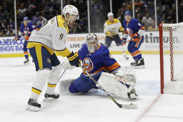 New York Islanders goaltender Semyon Varlamov, right, defends against Nashville Predators' Filip Forsberg during the third period of an NHL hockey game Tuesday, Dec. 17, 2019, in Uniondale, N.Y. The Predators won 8-3. (AP Photo/Frank Franklin II)