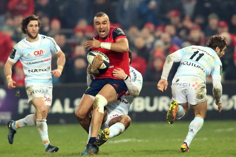 Munster's full-back Simon Zebo (C) is tackled during their European Rugby Champions Cup pool 1 match against Racing 92, at Thomond Park in Limerick, Ireland, on January 21, 2017