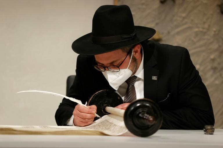 Rabbi Shaul Nekrich takes part in a ceremony to complete the historic Sulzbach Torah Scroll from 1792, rediscovered in 2013 and just restored, on the 76th anniversary of the liberation of Nazi Germany's Auschwitz death camp