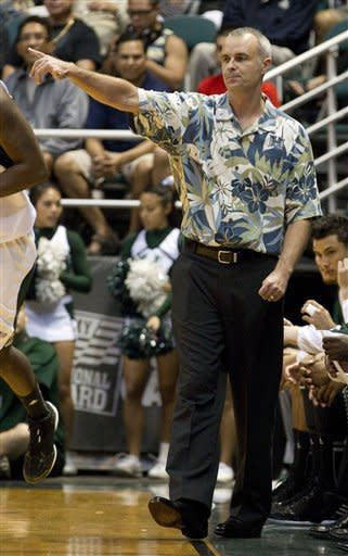 Hawaii head coach Gib Arnold calls a play while his team takes on Miami in the first half of an NCAA college basketball game in the Diamond Head Classic Saturday, Dec. 22, 2012, in Honolulu. (AP Photo/Eugene Tanner)