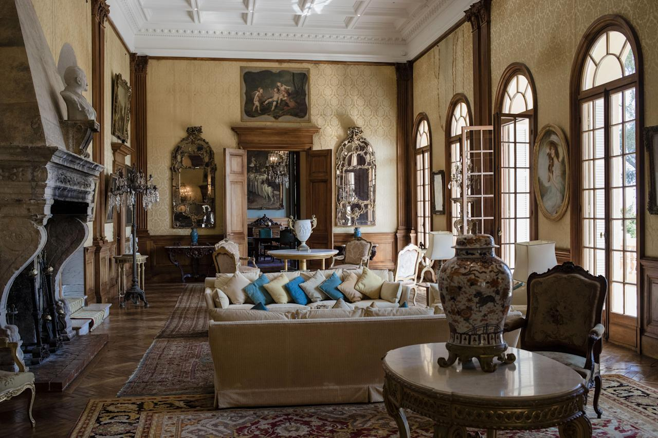 <p>Cushions rest on sofas of a sitting room inside the villa, which was built in 1830 and bought in 1850 by the mayor of Villefranche-sur-Mer, when it operated as an olive tree farm </p>