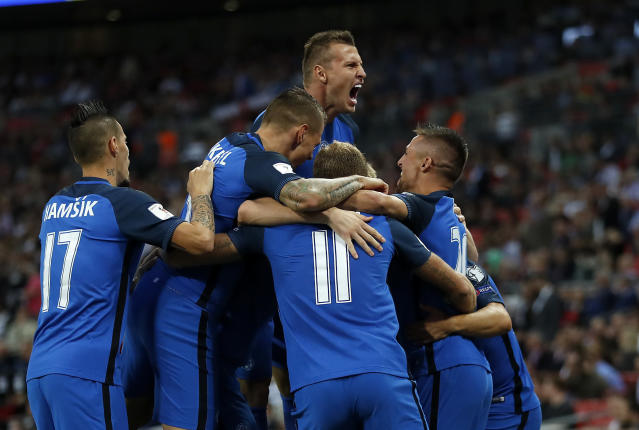 <p>Slovakia's team celebrates scorer Stanislav Lobotka after scoring the opening goal during the World Cup Group F qualifying soccer match between England and Slovakia at Wembley Stadium in London, England, Monday, Sept. 4, 2017. (AP Photo/Kirsty Wigglesworth) </p>