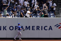 Kansas City Royals right fielder Ryan O'Hearn, lower left, watches as a fan reach for a solo home run hit by New York Yankees Aaron Judge during the first inning of a baseball game, Thursday, June 24, 2021, at Yankee Stadium in New York. (AP Photo/Kathy Willens)