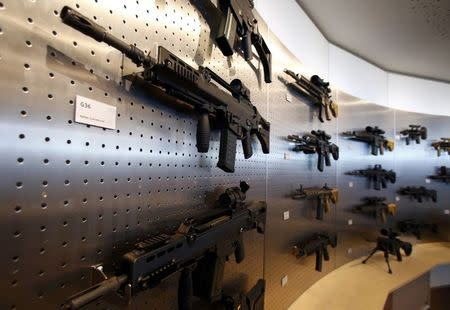 HK G 36 (L) guns are pictured at a show room of arms manufacturer Heckler & Koch during a guided media tour at Heckler & Koch headquarters in Oberndorf, 80 kilometers southwest of Stuttgart, Germany, May 8, 2015. REUTERS/Ralph Orlowski